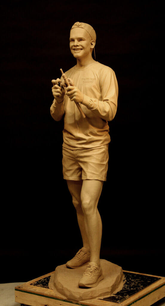 A sculpture of a young fisherman
