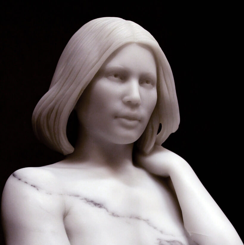 Marble bust of a beautiful woman. Marble sculpture bust.