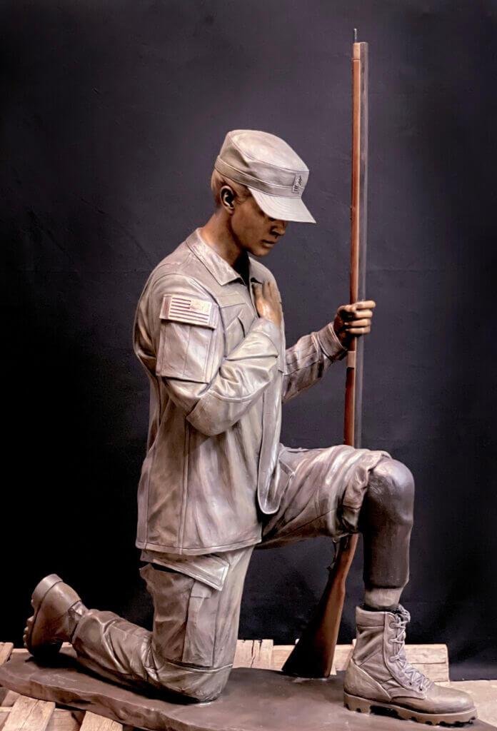 Bronze sculpture of a kneeling soldier. Military bronze sculpture.