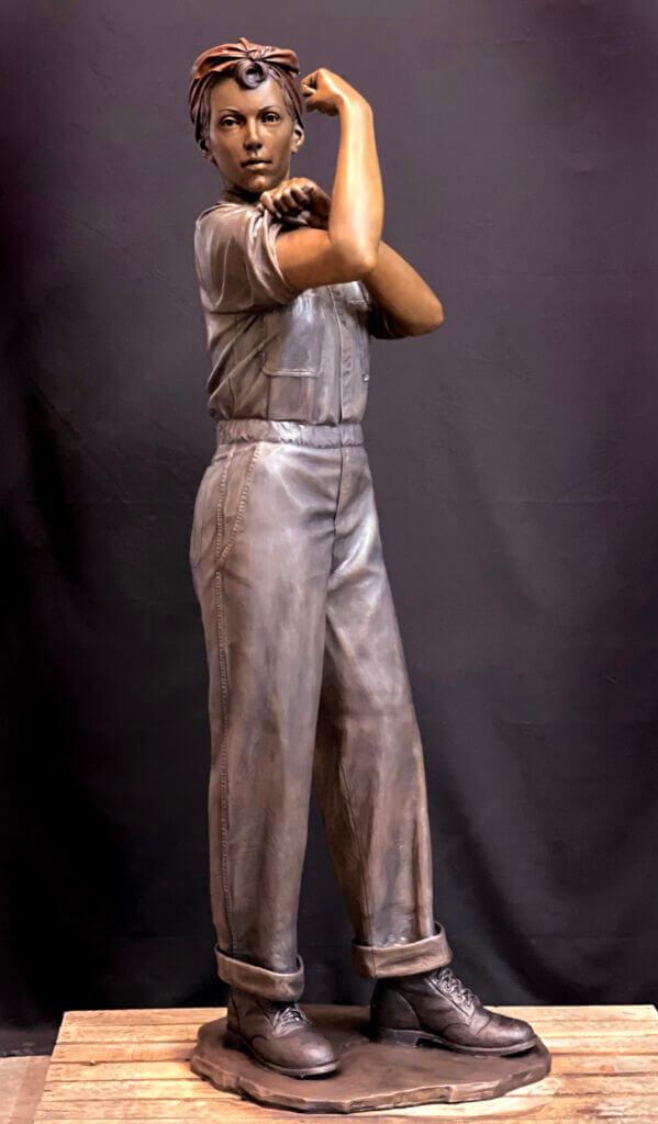 Bronze sculpture of Rosie The Riveter. Life size statue of Rosie The Riveter.