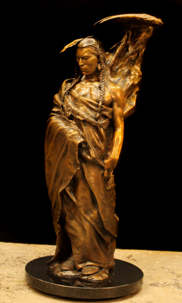 Bronze sculpture of a Native American with an eagle